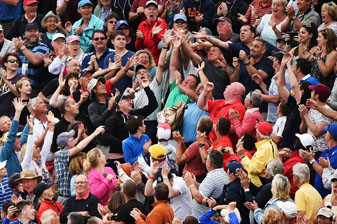 Fans at Royal Liverpool try to catch Rory McIlroy's golf ball after McIlroy threw it into the crowd on the 18th green Sunday.