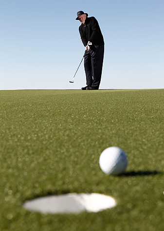 A taller, more open address improves your depth perception               and distance control so you can roll long putts this close.