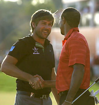 Robert Rock beat Tiger Woods by two shots in the final round in Abu Dhabi.