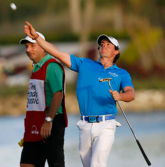 Rory McIlroy celebrated a two-shot win that capped his rise to No. 1.