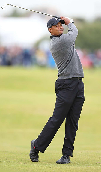 Tiger Woods fired a second straight 67 on Friday and trails Brandt Snedeker by four shots.