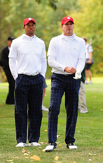 Tiger Woods and Steve Stricker lost their morning match 2 and 1 to Ian Poulter and Justin Rose.