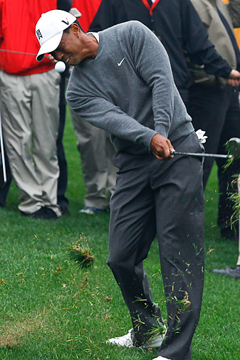 Tiger Woods, shown here competing in Monday's exhibition against Rory McIlroy in China, has finished in the top 10 in four straight tournaments.