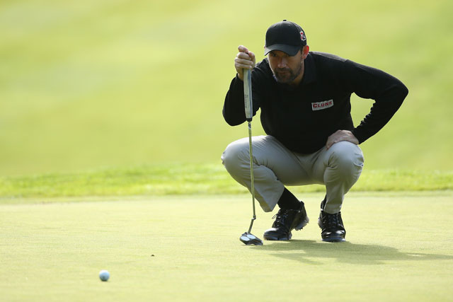 Padraig Harrington lines up a putt during the first round of the BMW PGA Championship at Wentworth.