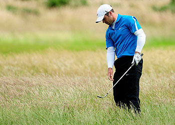 Paul Casey playing his second shot on the 17th hole at St. Andrews Friday.