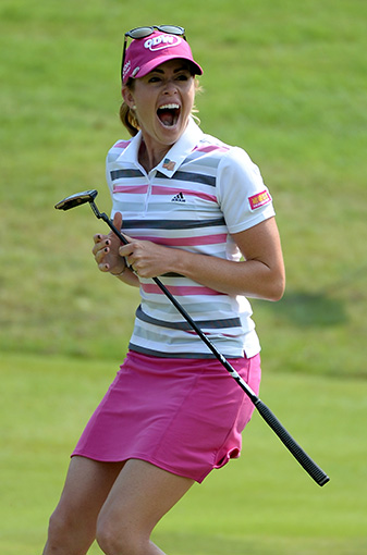 Paula Creamer celebrates sinking a 75-foot eagle putt on the second extra hole to win the HSBC Women's Champions.