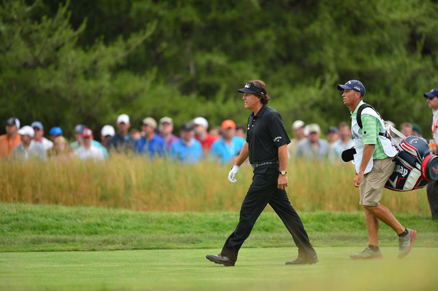 Phil Mickelson (with Jim Mackay) needs a victory in the U.S. Open to become the sixth player to win the modern Grand Slam.