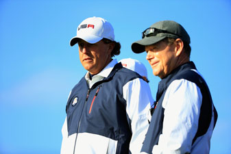 Phil Mickelson talks with captain Tom Watson during the Friday morning fourballs.