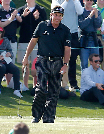 Phil Mickelson walks off the green after his putt for a 59 lipped out.