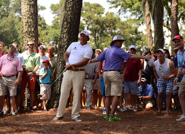 Phil Mickelson hits from the pine straw on the second hole of his second round at the Players Championship.