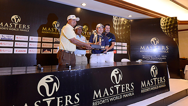 Mardan Mamat of Singapore, Antonio Lascuna of the Philippines, Angelo of the Philippines and Daniel Chopra of Sweden pose wih the event trophy ahead of the Resorts World Manila Masters.