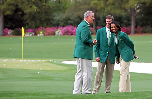 Condoleezza Rice, right, laughs on the practice range with members Dave Dorman, left, and Pat Battle, center, on Sunday.