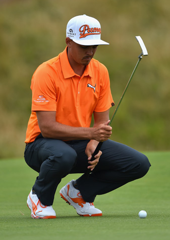 Rickie Fowler lines up a putt during the final round of the Open Championship.