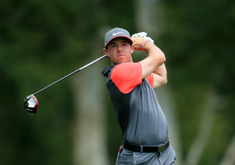Rory McIlroy tees off on the eighth hole during the first round of the PGA Championship.