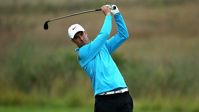 Ross Fisher held off Michael Hoey to win his fifth European Tour title.