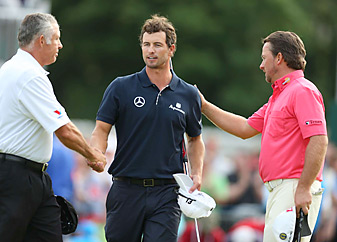 Adam Scott's collapse stunned his caddie Steve Williams (left) and playing partner, Grame McDowell.