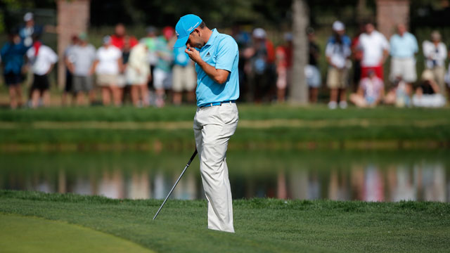 Sergio Garcia reacts to his chip into the water on the 17th hole during the final round of the BMW Championship.