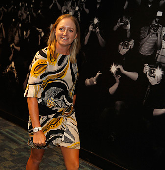 Stacy Lewis, walking in front of a mural of photographers at Verizon Arena in Little Rock, should get used to living her life in the spotlight.