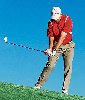 Drop your right foot back at address to level out your knees. This will also improve your balance.