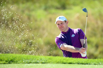 Stephen Gallacher chips out of a bunker during a practice round ahead of the 2014 Ryder Cup at Gleneagles.