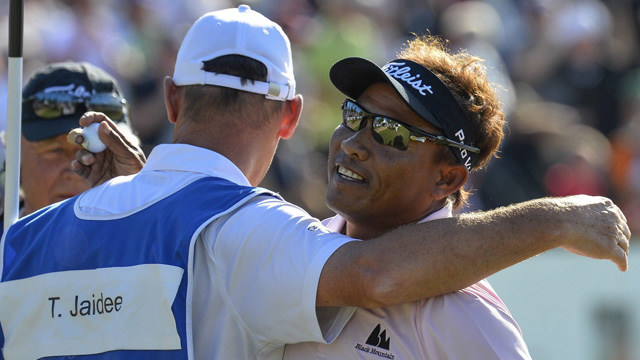Thongchai Jaidee hugs his caddie after winning the first playoff hole.