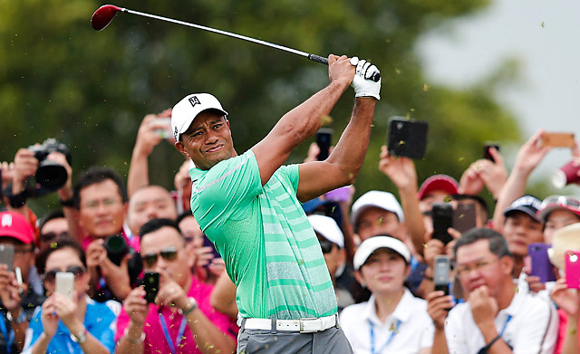 Tiger Woods, shown here competing against Rory McIlroy in their match earlier this week, will not compete at the HSBC Champions.