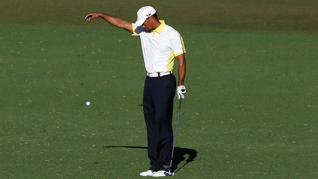 Tiger Woods moved two yards back from the site of the original shot, then unwittingly admitted to his rules violation in a postround interview.