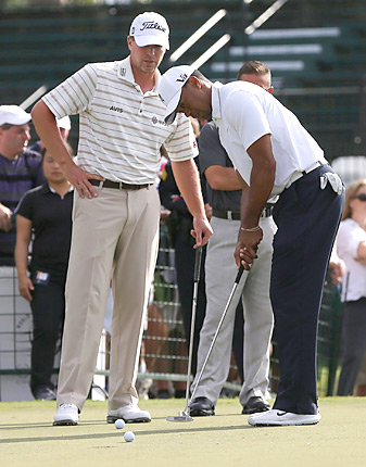 Woods got a lesson from Stricker, then beat his good buddy by two shots while attempting the fewest number of putts in his career.