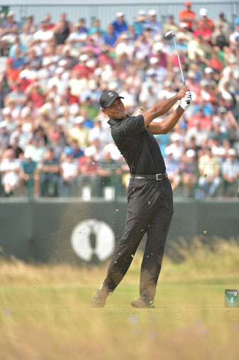 Tiger Woods hits from the rough in the second round of the British Open.