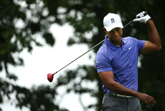 Tiger Woods reacts to his tee shot on the second hole during the opening round of the PGA Championship.