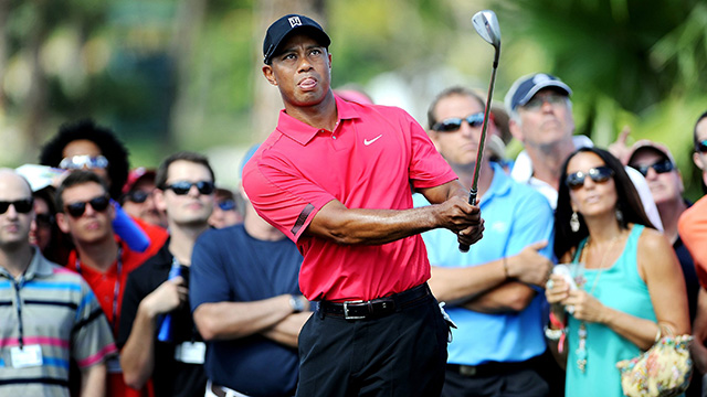 Tiger Woods was 5 over par and 12 shots off the lead when he withdrew from play after the 13th hole on Sunday.
