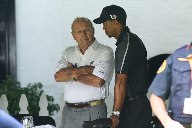 Arnold Palmer and Tiger Woods talk during last year's U.S. Open at Merion Golf Club.