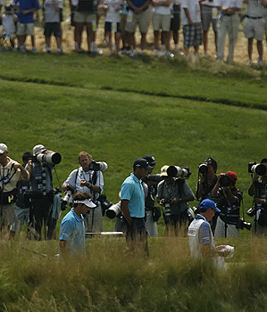 With an army of photographers between Tiger Woods and the fans, getting a glimpse of the world's No. 1 player can be tough.