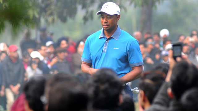 Tiger Woods walks at the Delhi Golf Club prior to playing an 18-hole round with special invitees in New Delhi on Tuesday.