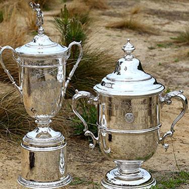 The men's and women's U.S. Open trophies.
