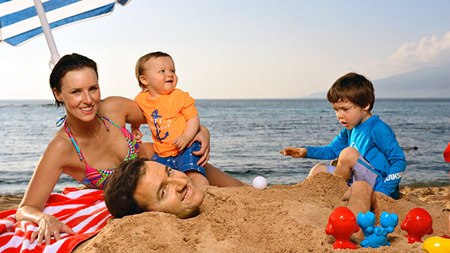 Aside from his family photo shoot with (from left) Erin, Beckett and Mclain, Walker was all business in Hawaii.