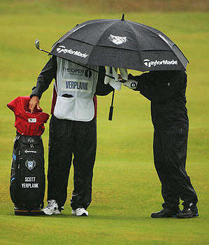 Scott Verplank and his caddy brace against Sunday morning's rain.