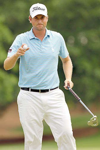 Webb Simpson shot a 69 to grab a one-shot lead at Quail Hollow.