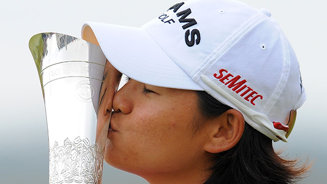 Yani Tseng kisses the trophy after winning the Women's British Open in 2011.