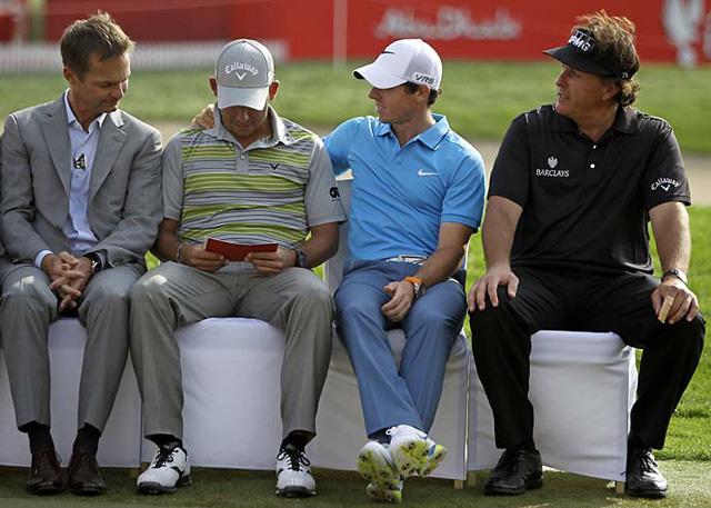 A gracious Rory McIlroy congratulates Abu Dhabi winner Pablo Larrazabal as Phil Mickelson looks on.