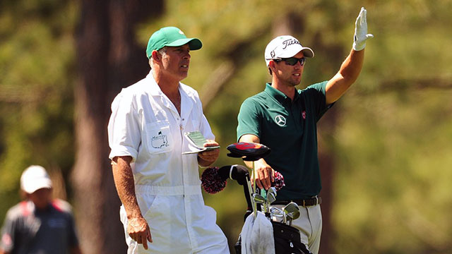 Adam Scott and his caddie Steve Williams line up a shot on the 14th hole at Augusta National.