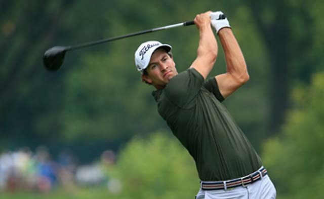 Adam Scott continued his assault on Oak Hill on Friday, shooting 68 to finish at 7-under after two rounds.