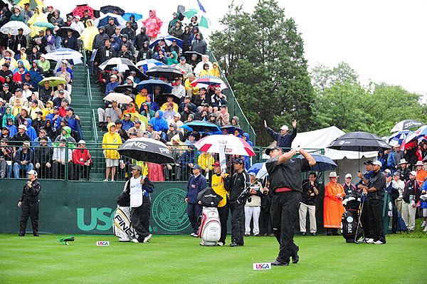 Woods played with Angel Cabera, the 2009 Masters and 2007 U.S. Open champ, and Padraig Harrington, who won the 2007 and 2008 British Opens and the 2008 PGA Championship.