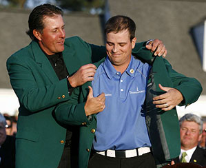 Phil Mickelson presented the green jacket to Zach Johnson, who said afterward that it was a 40 regular.