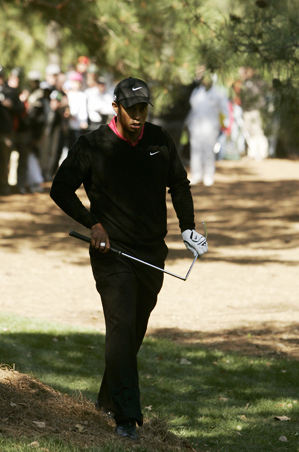 Tiger Woods walked away with his bent club.