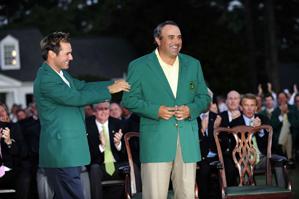 Trevor Immelman, left, helped Angel Cabrera into his green jacket.