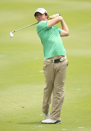Rory McIlroy fired an eight-under 64 to tie for the lead at the Malaysian Open.