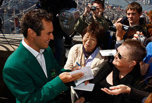 Trevor Immelman signed autographs Tuesday for fans while at the top of the Empire State Building in New York City.