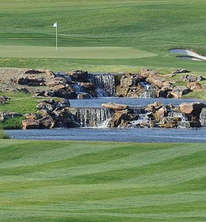 The renovations on the 18th at TPC Four Seasons Resort include a rushing, 170-yard-long water hazard.