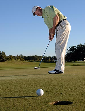 Set the base of your neck parallel to the ground to set up a tension-free stroke.